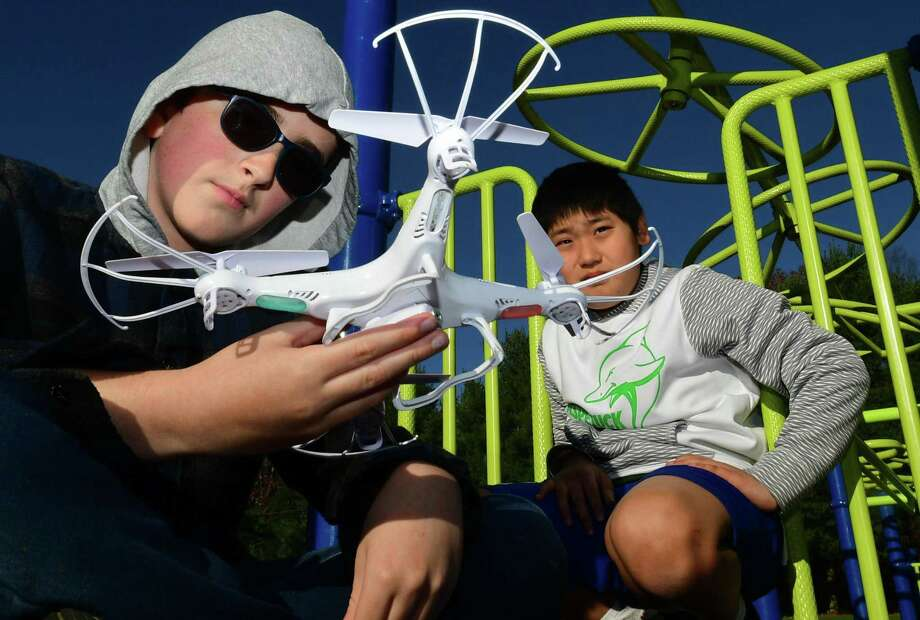Sixth graders Rober Puorro and james Lillis prepare to fly their drone in the Middlebrook Middle School Drone Flying Crew after school program Nov. 1. Photo: Erik Trautmann / Hearst Connecticut Media / Norwalk Hour