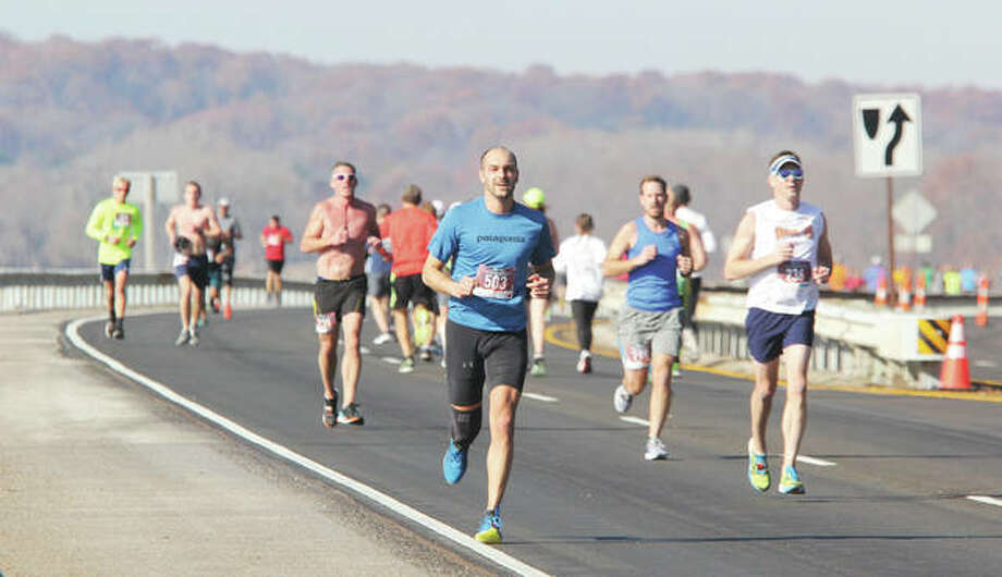 Runners go in both directions near the half-way point during the 59th Annual Great River Road Run last year. This year's 60th annual run is set for Saturday, Nov. 30 in Alton. It will feature 10-mile and 5K runs. About 700 people participate each year in the run, sponsored by the Alton Road Runners Club.
