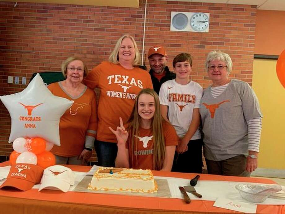 Dow High's Anna Jensen is joined by her family after signing with the University of Texas rowing program.