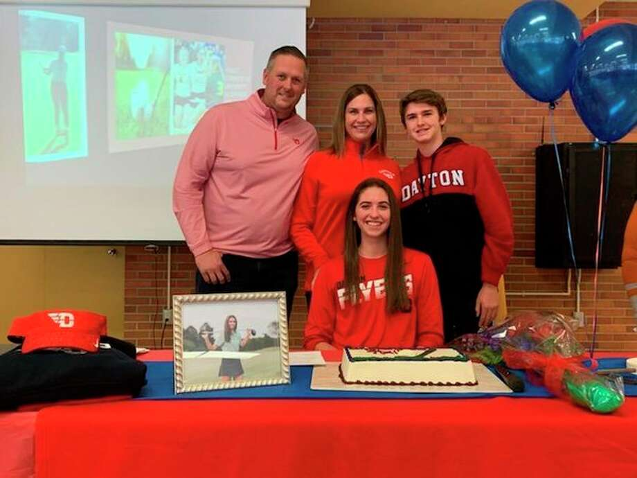 Dow High's Hailey Tanis is joined by her family after signing with the University of Dayton women's golf program on Wednesday.