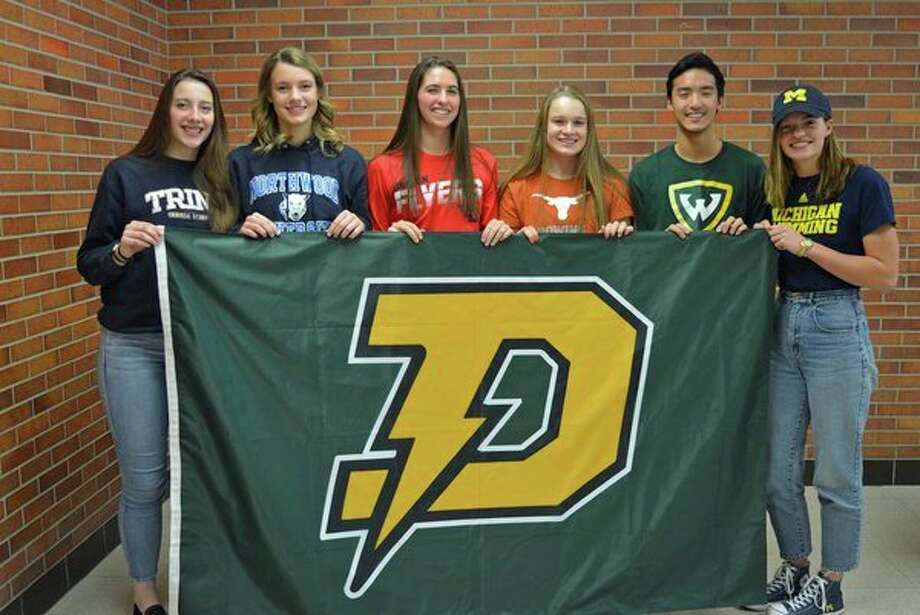 Six Dow High senior student-athletes posed for a photo on Wednesday at the school after signing letters of intent with their respective universities. Pictured, from left, are Alyssa Keptner (Trine University women's lacrosse), Haley Jaster (Northwood University volleyball), Hailey Tanis (University of Dayton women's golf), Anna Jensen (University of Texas rowing), Collin Che (Wayne State University men's swimming) and Claire Newman (University of Michigan women's swimming).