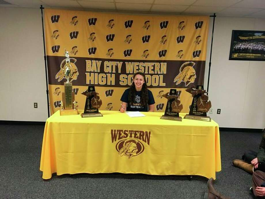 Bay City Western's Adaline Ziehmer signs with the Cedarville University softball program on Wednesday.