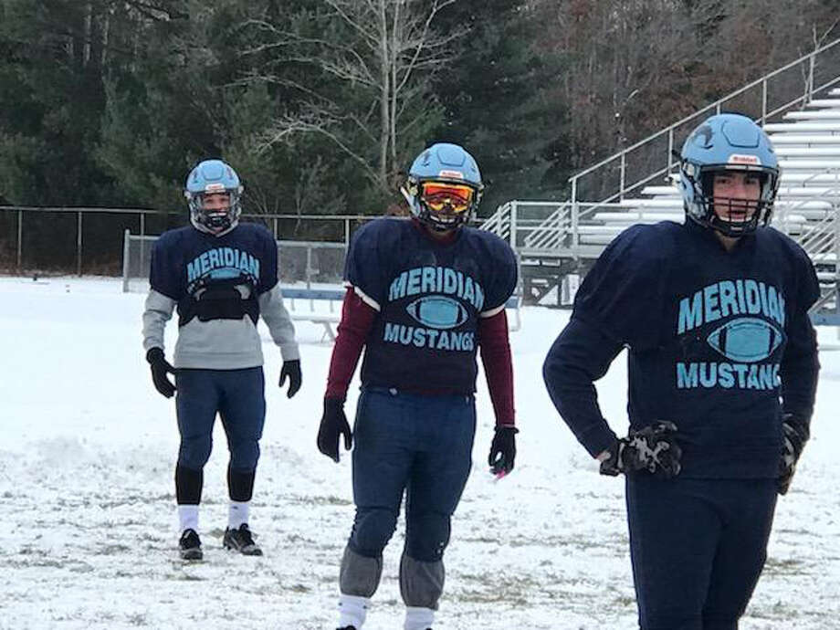 Meridian football players, from left, Brady Solano, Josh Barriger and Gabe Sturgeon are shown at practice at the Mustangs' field this week in preparation for Saturday's Division 6 regional final at Montague. Photo: Photos Provided/Rod Barriger