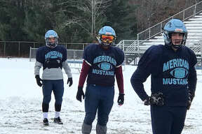 Meridian football players, from left, Brady Solano, Josh Barriger and Gabe Sturgeon are shown at practice at the Mustangs' field this week in preparation for Saturday's Division 6 regional final at Montague.