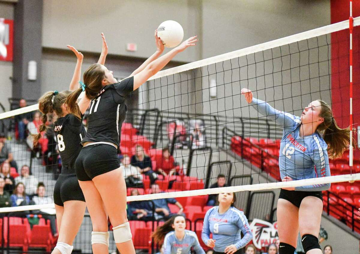 Hargrave's Kylie Willis (11) and Laynee Beam (8) go for a block during the Regional Quarterfinal match against Lumberton on Nov. 12 at Lee College in Baytown