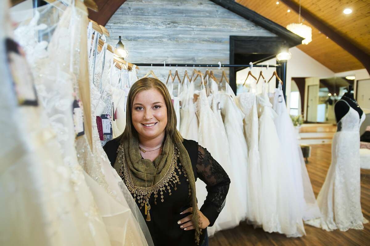 Hannah Merillat, owner of Three Diamonds Bridal Boutique, poses for a portrait inside the business at 230 W. Saginaw Road in Sanford. The boutique will host an open house Dec. 6, 2019. (Katy Kildee/kkildee@mdn.net)