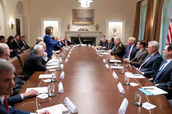 """In this handout provided by the White House, U.S. President Donald Trump meets with House Speaker Nancy Pelosi and Congressional leadership in the Cabinet Room of the White House October 16, 2019 in Washington, DC. Pelosi later said Trump referred to her as a """"third-grade politician."""" (Shealah Craighead/The White House via Getty Images/TNS)"""