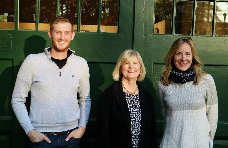 Aaron Lefland, executive director of the New Canaan Land Trust; Catharine Sturgess, vice president of the board of the New Canaan Land Trust: and Hilary Wittmann, executive director, of the Carriage Barn Arts Center. Photo: Contributed Photo
