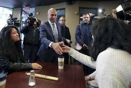 Democratic presidential candidate former Massachusetts Gov. Deval Patrick campaigns Thursday, Nov. 14, 2019, at The Bridge Cafe in Manchester, N.H. (AP Photo/Charles Krupa)