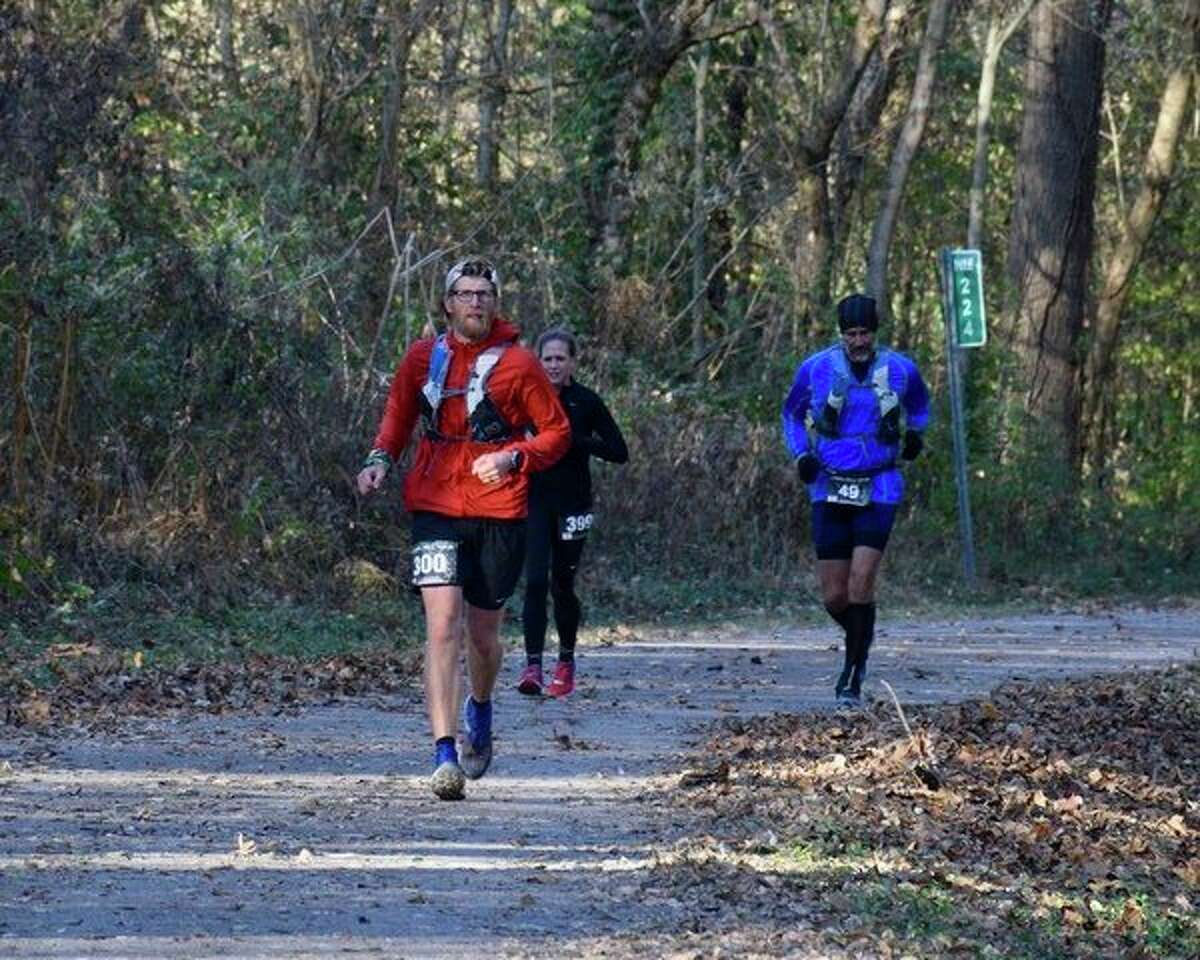 USA cross country coach Mike Peter leads a couple of runners last weekend during theTunnel Hill 100 in Vienna, Illinois. (Courtesy Photo)