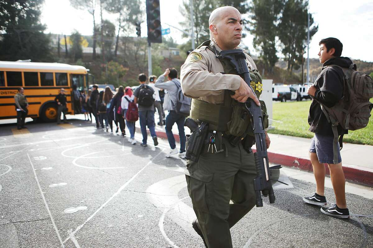 SANTA CLARITA, CALIFORNIA - NOVEMBER 14: Students are evacuated from Saugus High School onto a school bus after a shooting at the school left two students dead and three wounded on November 14, 2019 in Santa Clarita, California. A suspect in the shooting is being treated at a local hospital for a gunshot wound to the head.