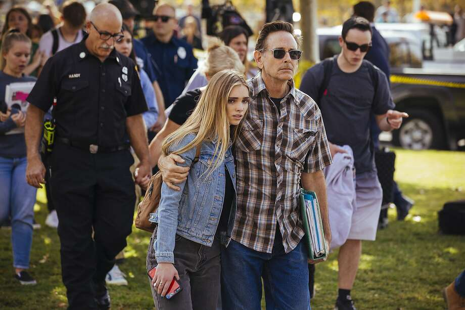 Students are reunited with their parents after a shooting at Saugus High School in Santa Clarita, Calif., on Thursday, Nov. 14, 2019. A 16-year-old student pulled a handgun from his backpack at the school on Thursday morning and shot five students, killing two, the authorities said. The gunman was in grave condition after shooting himself in the head, they said. (David Walter Banks/The New York Times) Photo: David Walter Banks, NYT