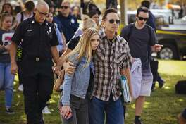 Students are reunited with their parents after a shooting at Saugus High School in Santa Clarita, Calif., on Thursday, Nov. 14, 2019. A 16-year-old student pulled a handgun from his backpack at the school on Thursday morning and shot five students, killing two, the authorities said. The gunman was in grave condition after shooting himself in the head, they said. (David Walter Banks/The New York Times)
