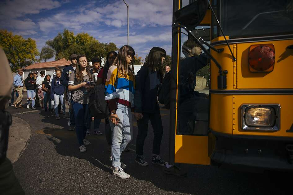 Students are evacuated on busses after a shooting at Saugus High School in Santa Clarita, Calif., on Thursday, Nov. 14, 2019. A 16-year-old student pulled a handgun from his backpack at the school on Thursday morning and shot five students, killing two, the authorities said. The gunman was in grave condition after shooting himself in the head, they said. (David Walter Banks/The New York Times)