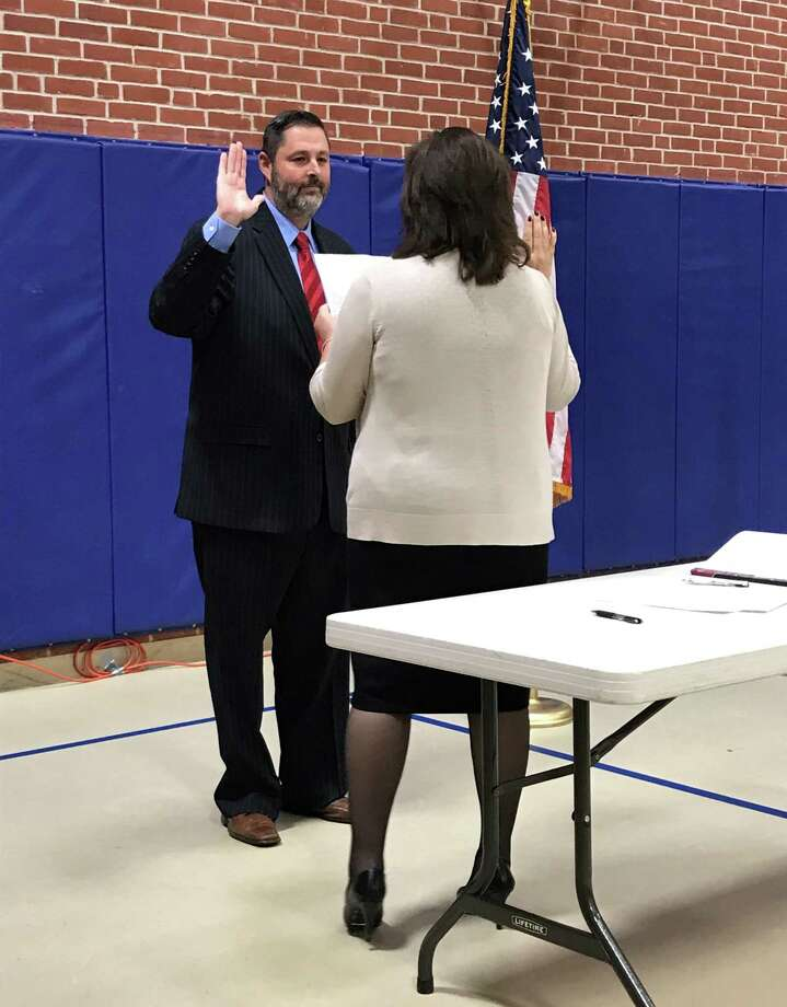 The elected officers of the town of Cromwell, the members of the various boards, commissions, and agencies, were sworn in in a ceremony this week in the Town Hall gymnasium. Photo: Jeff Mill / Hearst Connecticut Media