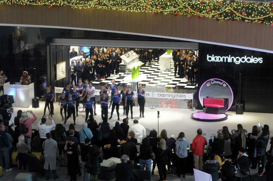 A youth group performs in mid-November 2019 outside Bloomingdale's at The SoNo Collection mall in Norwalk, Conn. Operator Brookfield Properties has implemented requirements at malls in Waterbury and Manchester that teens under the age of 18 must be accompanied by an adult on select days and evenings in the 2019 holiday season. Photo: Ned Gerard / Hearst Connecticut Media / Connecticut Post