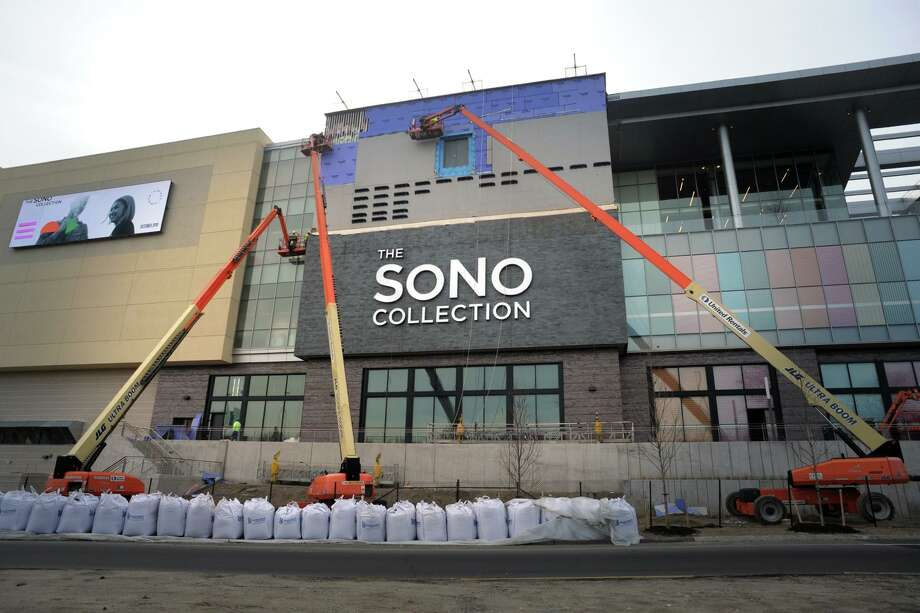 Work continues in mid-November 2019 on the exterior of the SoNo Collection mall in Norwalk, Conn. Photo: Ned Gerard / Hearst Connecticut Media / Connecticut Post