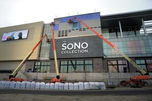 Work continues on the exterior of the SoNo Collection mall in Norwalk, Conn. Nov. 14, 2019. A worker fell to his death while working on the mall early Tuesday morning.