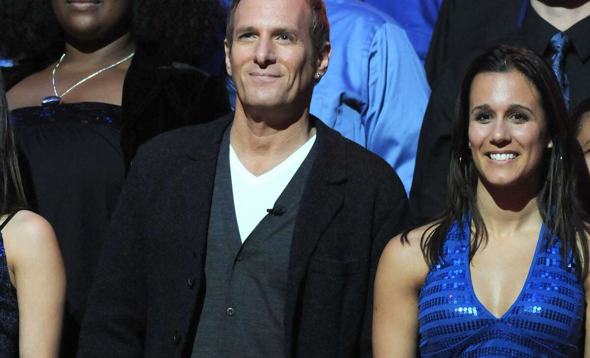 BROOKLYN, NY - DECEMBER 16: Singer Michael Bolton and Host Maria Menounos along with members from his New Haven based choir during the Clash of the Choirs rehearsal show at the Steiner Studios in Brooklyn on December 16, 2007 in New York. (Photo by George Napolitano/FilmMagic)