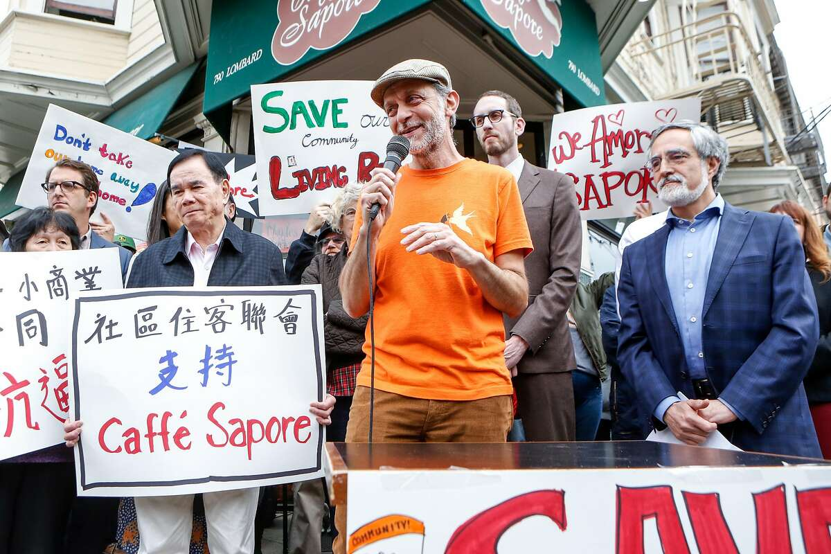 Owner of Caffe Sapore, Elias Bikahi, speaks at a demonstration gathering in support of saving his long-time neighborhood cafe in North Beach San Francisco, Calif. on Thursday, Nov. 14, 2019.