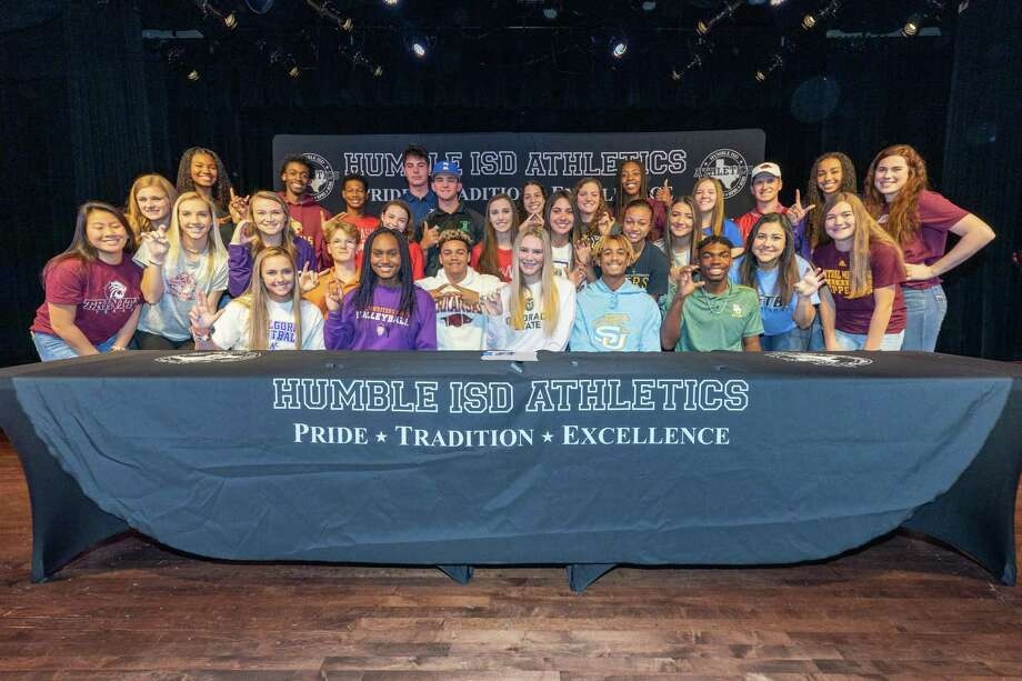 30 Humble ISD student athletes signed letters of intent to play in college on National Signing Day at the Charles Bender Performing Arts Center in Humble. Photo: Humble ISD Contributed Photo