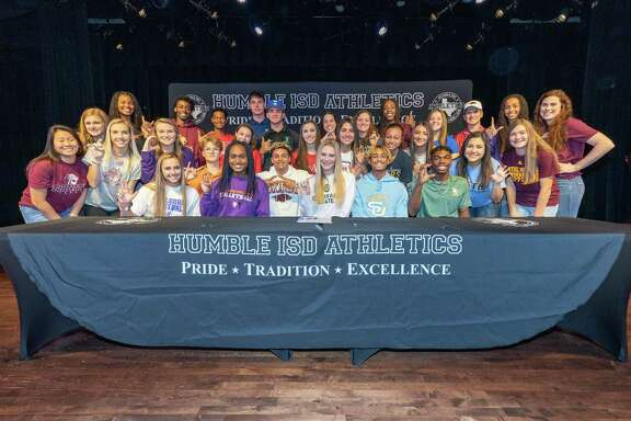 30 Humble ISD student athletes signed letters of intent to play in college on National Signing Day at the Charles Bender Performing Arts Center in Humble.