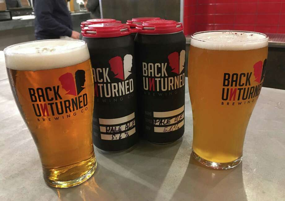 A pale ale (left) and a farmhouse ale will be the first two featured beers at Back Unturned Brewing Co. Beer is also available in four-packs ($16) to go. Photo: /