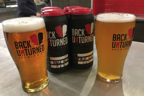 A pale ale (left) and a farmhouse ale will be the first two featured beers at Back Unturned Brewing Co. Beer is also available in four-packs ($16) to go.