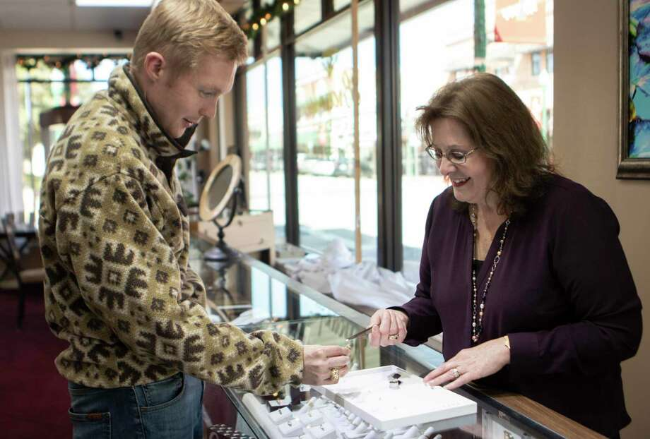 Brownlee Jewelers owner Janice Parish helps Brenham resident Wayne Beckermann select a diamond for an engagement ring Wednesday, Nov. 21, 2018 at Brownlee Jewelers in downtown Conroe. Check out Brownlee's selections for your upcoming holiday giving. Photo: Cody Bahn, Houston Chronicle / Staff Photographer / © 2018 Houston Chronicle