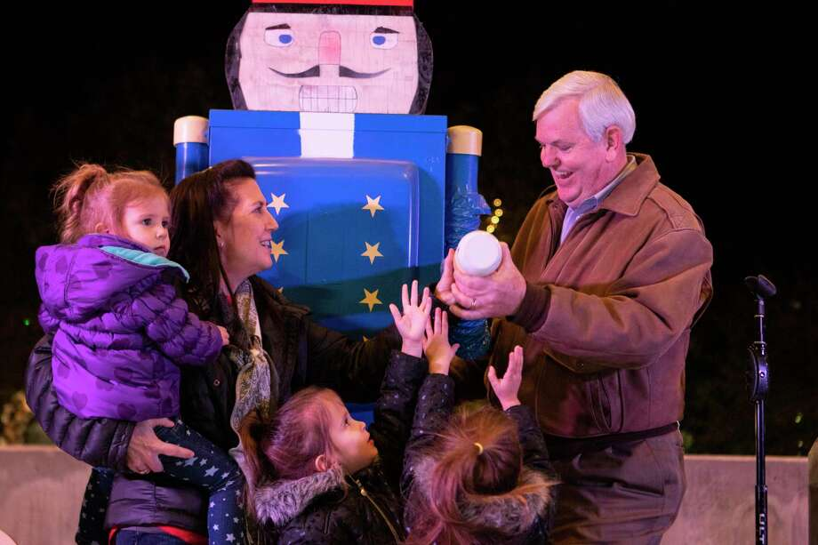 President of First National Bank in Conroe George Waggoner, his wife Sheila Waggoner and their family flip the switch to turn on the Conroe Christmas Tree lights during the annual Tree Lighting Ceremony on Tuesday, Nov. 27, 2018 at Heritage Place Park in Conroe. This year's tree lighting is set for Tuesday at 6 p.m. Photo: Cody Bahn, Houston Chronicle / Staff Photographer / © 2018 Houston Chronicle