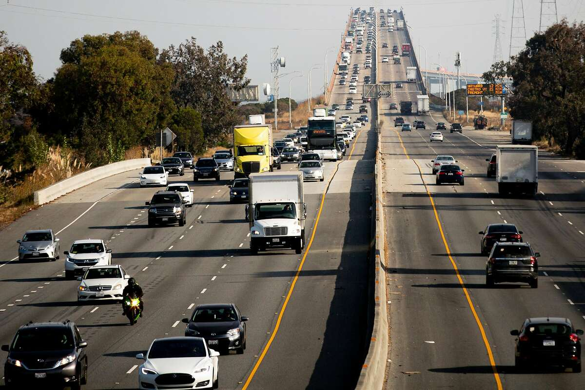 Motorists on the left completed the drive past the San Mateo-Hayward Bridge on Wednesday, Nov. 13, 2019, in Foster City, Calif.