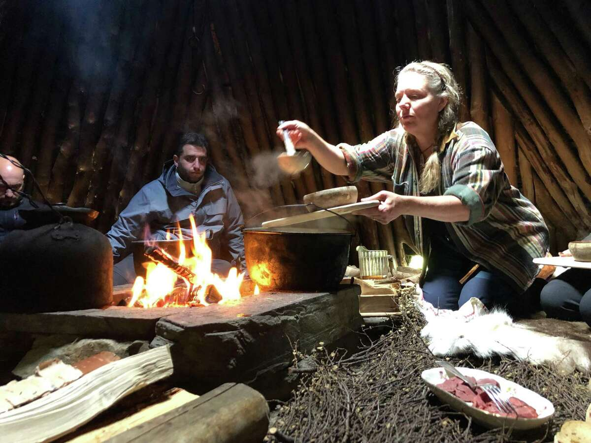Anki Vinka serves lunch inside a traditional Sami tepee-like structure called a goathie. (Mark Johanson/Chicago Tribune/TNS)