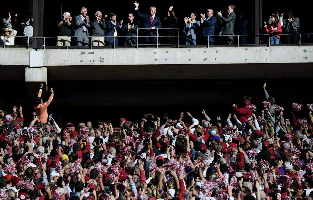 President Donald Trump and first lady Melania Trump are cheered during the LSU-Alabama football game. But Trump was booed at a Washington Nationals game. A reader says this reflects the nation's historical divide.
