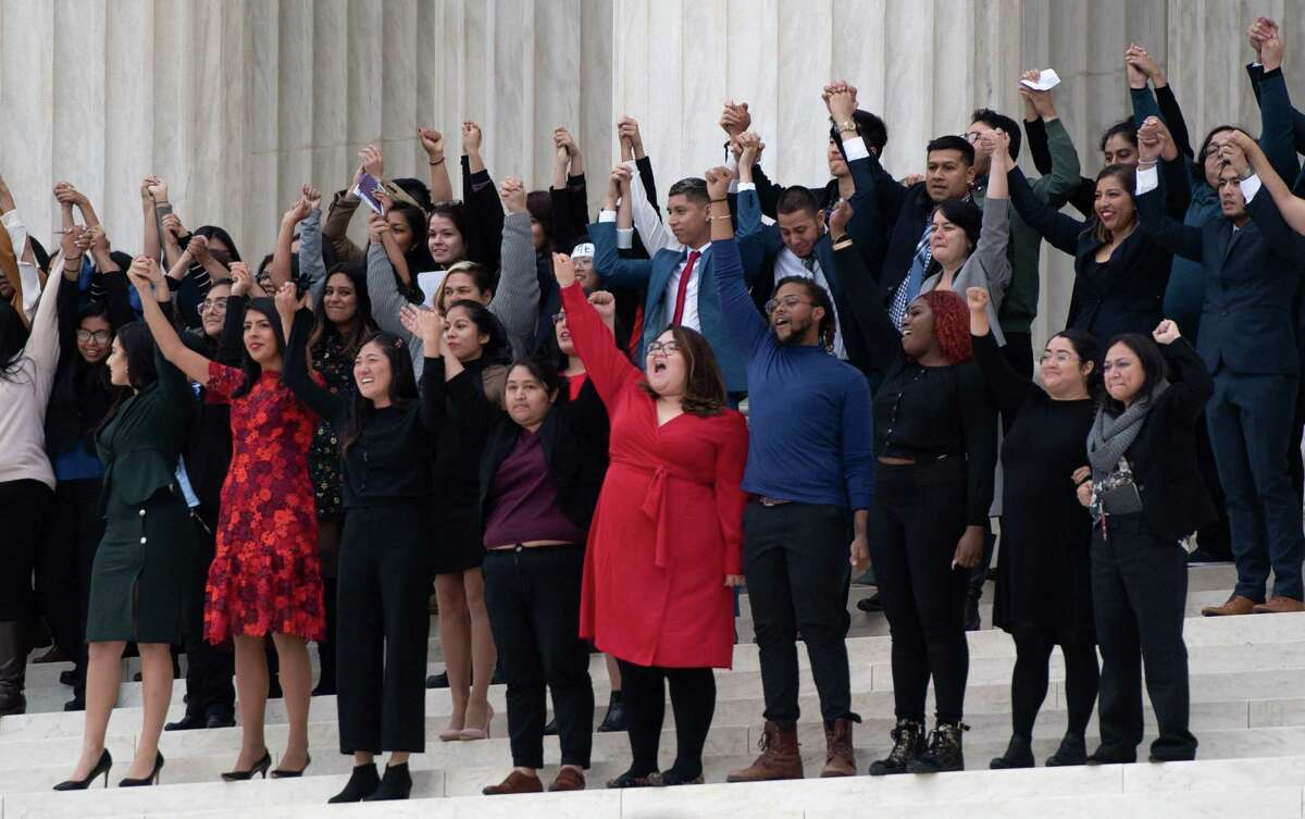 Dreamers stand outside the U.S. Supreme Court in 2019. The court's ruling is a win for Dreamers, but the fight continues for a path to citizenship. If you really believe Dreamers belong here, you need to be willing to fight for a long-term solution for them and their family members.