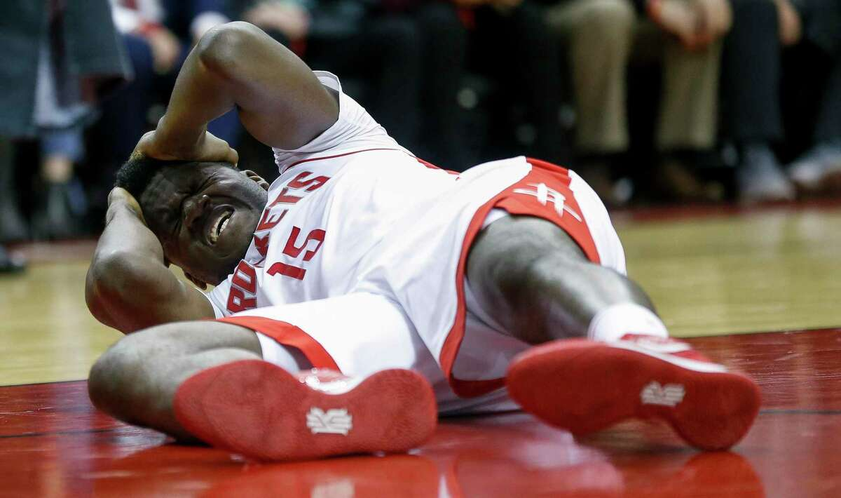 Houston Rockets center Clint Capela (15) holds his head after being fouled during the second half of an NBA game against the LA Clippers at the Toyota Center Wednesday, Nov. 13, 2019, in Houston.