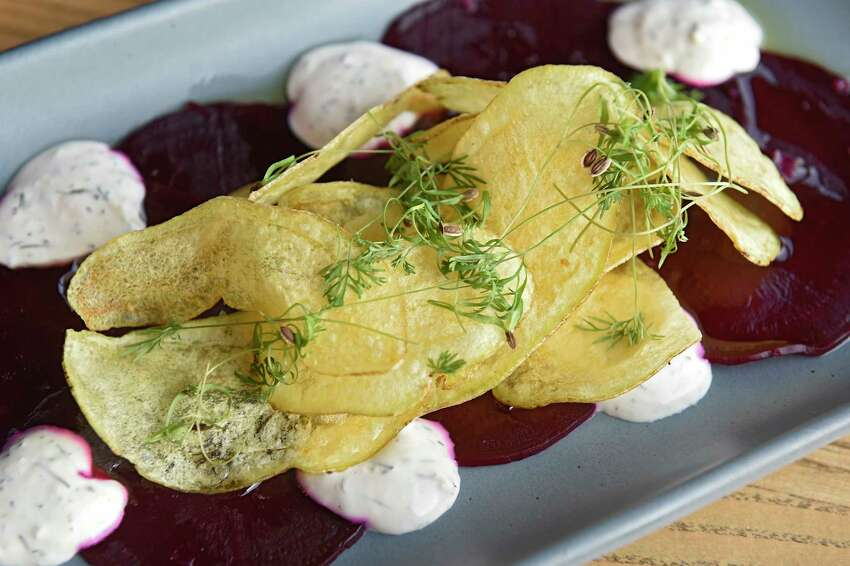 Roasted beet carpaccio - horseradish and dill crema, fingerling potato chips, fennel greens, flaked salt at Seneca restaurant on Wednesday, Nov. 6, 2019 in Saratoga Springs, N.Y. (Lori Van Buren/Times Union)