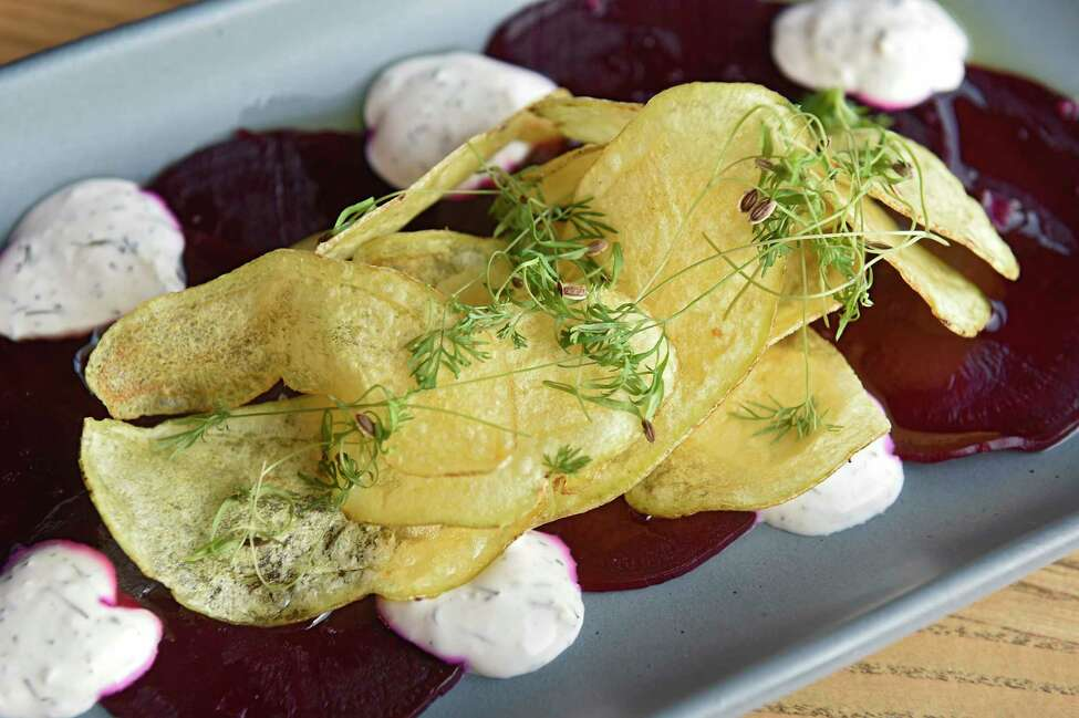 Roasted beet carpaccio - horseradish and dill crema, fingerling potato chips, fennel greens, flaked salt at Seneca restaurant on Wednesday, Nov. 6, 2019 in Saratoga Springs, N.Y. (Lori Van Buren/Times Union)