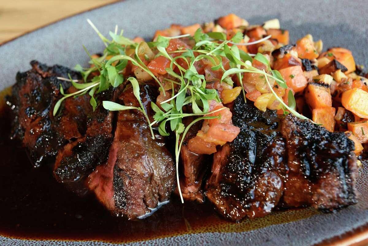 Wood-grilled hangar steak - sweet potato and rutabaga hash, charred tomato salsa, bell pepper, bordelaise at Seneca restaurant on Wednesday, Nov. 6, 2019 in Saratoga Springs, N.Y. (Lori Van Buren/Times Union)