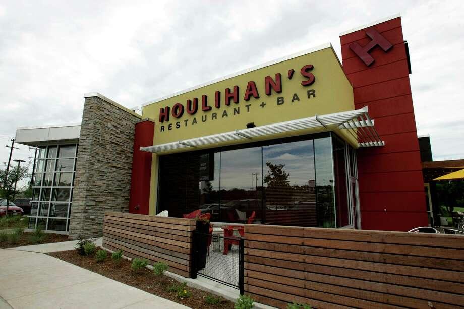 Houlihans Restaurant and Bar near Blanco Road in San Antonio. >> See the following photos of Tilman Fertitta's real estate ... Photo: KEVIN GEIL, STAFF / SAN ANTONIO EXPRESS-MESSAGES / SAN ANTON IO EXPRESS NEWS