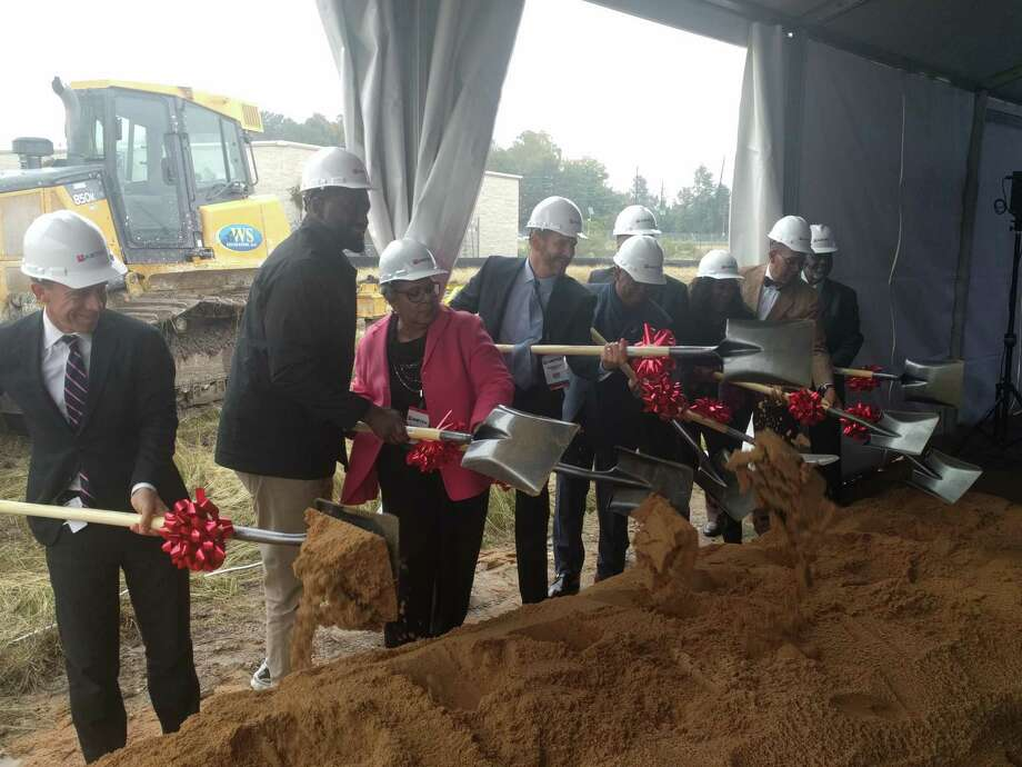 City and state officials and Amtex representatives break ground for the Green Oaks Apartments development. The affordable housing development is expected to be completed in 2021. Photo: Paul Wedding