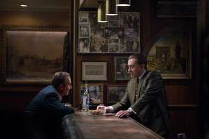 "This image released by Netflix shows Joe Pesci, left, and Robert De Niro in a scene from ""The Irishman."" (Niko Tavernise/Netflix via AP)"
