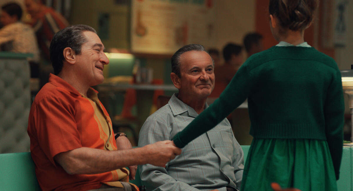 This image released by Netflix shows Robert De Niro, left, and Joe Pesci in a scene from