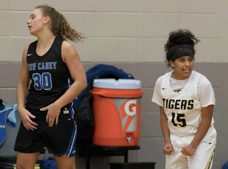 Conroe guard Daniela Galindo (15) reacts in front of New Caney power forward Abigail Lynch (30) after defeating the Lady Eagles 41-37 in overtime of a high school girls basketball game during the Lady Tiger Classic at Conroe High School, Thursday, Nov. 14, 2019, in Conroe. Photo: Jason Fochtman, Houston Chronicle / Staff Photographer / Houston Chronicle