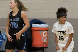 Conroe guard Daniela Galindo (15) reacts in front of New Caney power forward Abigail Lynch (30) after defeating the Lady Eagles 41-37 in overtime of a high school girls basketball game during the Lady Tiger Classic at Conroe High School, Thursday, Nov. 14, 2019, in Conroe.