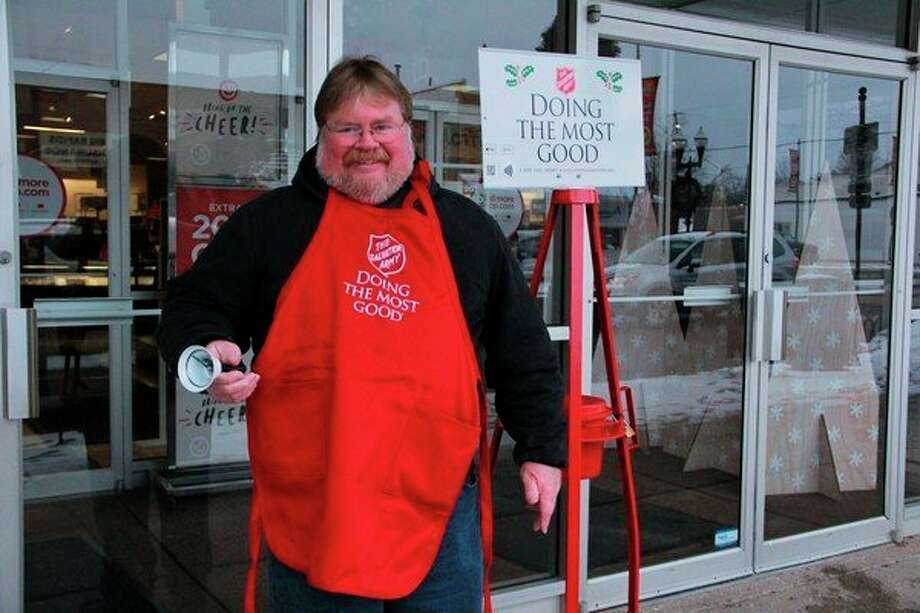 Salvation Army bell ringer Brian Carr spent his Thursday morning giving back as he stood in front of JCPenny in Big Rapids, asking locals for donations. According to Salvation Army Envoy Ed Hoskins, donations made during the red kettle campaign can provide Salvation Army with various opportunities to give back to the community, as well as those in need. (Pioneer photo/Alicia Jaimes)