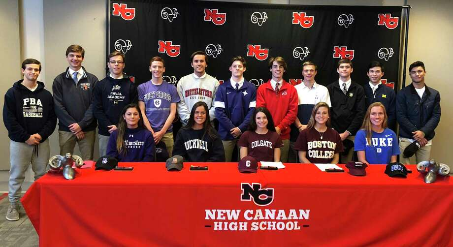 A group of 16 New Canaan High School athletes signed their National Letters of Intent during a ceremony in the Wagner Room at NCHS on Wednesday, Nov. 13, 2019. From left, front row (seated), Natalie Lopez (Northwestern lacrosse), Kearney McKiernan (Bucknell lacrosse), Alexandra Mehos (Colgate swimming), Amanda Hall (Boston College crew), and Jane Charlton (Duke lacrosse); back row (standing), Frankie Ramppen (Palm Beach Atlantic University baseball), Maxwell Orwicz (Bucknell golf), Jack Hagan (Furman lacrosse), George Moore (US Naval Academy diving), Tim Manzella (Holy Cross swimming), Nash Hooper (Northeastern crew), Jack Finnigan (Utah lacrosse), Patrick Colwell (US Naval Academy swimming), Bennett Ong (USMA lacrosse), Justin Wietfeldt (Michigan lacrosse), and Tyler Sung (Lehigh wrestling). Photo: Dave Stewart / Hearst Connecticut Media / Hearst Connecticut Media