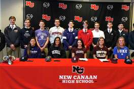 A group of 16 New Canaan High School athletes signed their National Letters of Intent during a ceremony in the Wagner Room at NCHS on Wednesday, Nov. 13, 2019. From left, front row (seated), Natalie Lopez (Northwestern lacrosse), Kearney McKiernan (Bucknell lacrosse), Alexandra Mehos (Colgate swimming), Amanda Hall (Boston College crew), and Jane Charlton (Duke lacrosse); back row (standing), Frankie Ramppen (Palm Beach Atlantic University baseball), Maxwell Orwicz (Bucknell golf), Jack Hagan (Furman lacrosse), George Moore (US Naval Academy diving), Tim Manzella (Holy Cross swimming), Nash Hooper (Northeastern crew), Jack Finnigan (Utah lacrosse), Patrick Colwell (US Naval Academy swimming), Bennett Ong (USMA lacrosse), Justin Wietfeldt (Michigan lacrosse), and Tyler Sung (Lehigh wrestling).