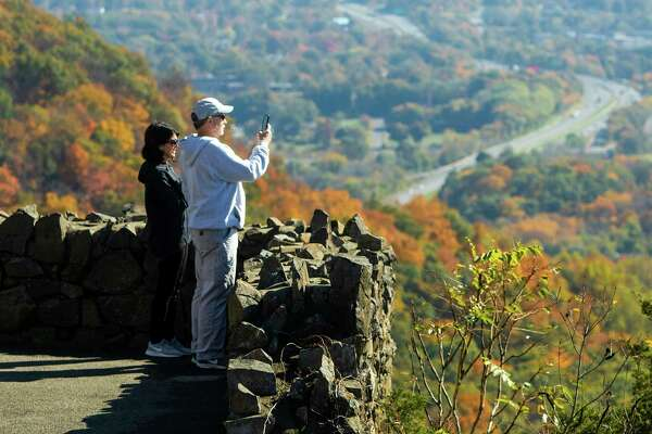 Paul and Nancy Reiman capture a photo of the fall foliage from Castle Craig in Meriden Oct. 21, 2019.