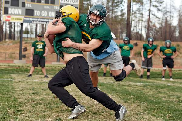 Paradise High School's Ashton Wagner tackles RJ Young during football practice in Paradise, Calif., on Wednesday, November 13, 2019.