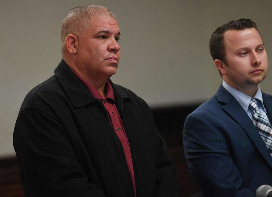Norwalk police office Hector Delgado, left, 46, of Stratford, appears with his lawyer Noah Kores in Superior Court in Bridgeport, Conn. on Tuesday, November 12, 2019. Photo: Brian A. Pounds / Hearst Connecticut Media / Connecticut Post